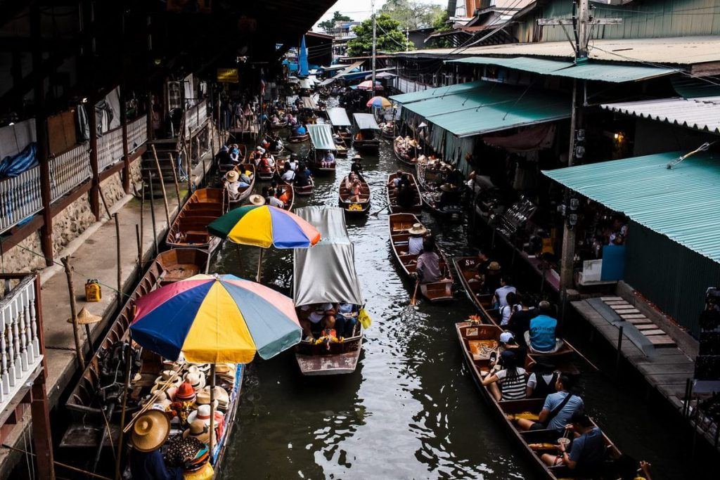 If you're an early riser, get your ass to Damnoen Saduak Floating Market for premo Thai street food.
