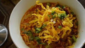 Khao Soi tastes as good as it looks, with its savory broth and slow cooked chicken.