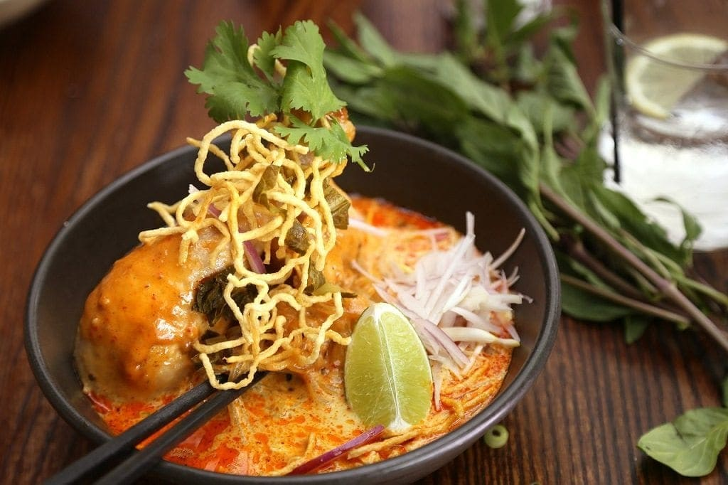 Khao Soi is a yellow curry soup popularized in Chiang Mai, Northern Thailand.