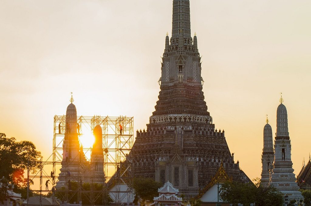 Wat Arun, the Temple of Dawn is ironically best visited at sunrise.