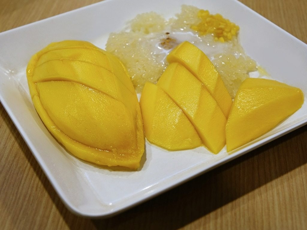 Mango sticky rice is a Thai delicacy enjoyed by locals and tourists alike.